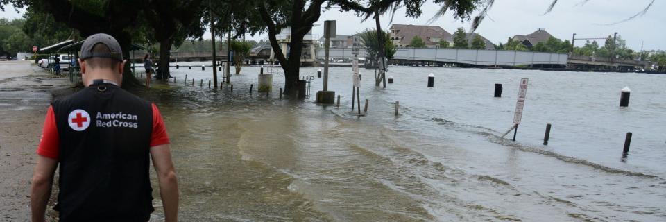 Red Cross worker, Matthew Teter, assessing flood water in Madisonville, LA.